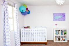 A lovely #lavender #nursery with cute #graphic #curtains & a cord-art wall piece.