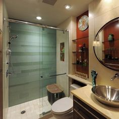Nice idea for my hall bath, recessed shelving over the toilet and the extended counter top.