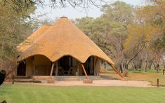 This hidden gem is set in a timeless corner of Africa in the mesmerising landscapes of the Northern Tuli Game Reserve. Round House Plans, My House Plans, African Hut, African Safari, Built In Braai, Village Inn, Saint Louis, Thatched Roof, Zoos