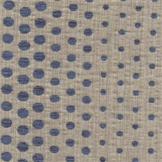 """This is a woven cotton chenille dot design reversable upholstery fabricin blue and beige. Dots ranging from 1/4"""" to 3/4"""" phasing in and out make a unique fabric suitable for any decor. Perfect for pillows and furniture.v584ARR"""