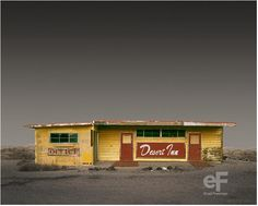"""Ed Freeman. Desert Realty-After a 25-year career in the music industry, during which he produced Don McLean's American Pie, Freeman returned to his original love of photography. While driving around southern Californian deserts to photograph landscapes, he was struck by the beauty of the desolate buildings he passed on the way. """"I wanted to appreciate these old, falling-apart buildings that no one pays any attention to. So I photographed them as if they were the most important thing on…"""
