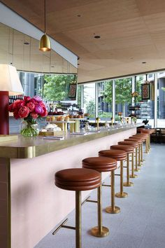 Bill Granger opens a new restaurant in London: table lamps sit on the rounded pink tiled and brass bar. Guests sit on diner-style leather and brass high stools. Cafe Restaurant, Restaurant Design, Architecture Restaurant, Restaurant Interiors, Restaurant Tables, Café Design, Bar Interior Design, Cafe Interior, Interior And Exterior