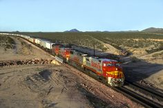 https://flic.kr/p/wdwtUg   1993-03-04 1706 ATSF 543 on #198 Essex, CA   One of Santa Fe's premium intermodal trains from Chicago to LA approaches the National Trails Highway overpass at Essex, CA.