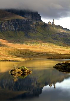 Looking up to the Old Man of Storr.  I love the little island in the foreground with the tiny tree. Gorgeous shot