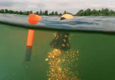 A spod crashes down to release it payload of bait - this is a brilliant way to accurately feed a carp swim at range