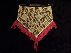 """Serue, woman's ceremonial apron  Geelvink Bay, West Papua New Guinea  Glass beads, fiber, trade cloth  Beaded area is 20"""" (51 cm) wide by 19"""" (48 cm) high  Early to mid-20th century"""