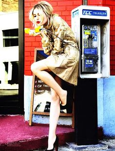 Inspired by - Editorial. Gold jacket. Red brick wall. Magenta sidewalk. Blue and silver phone. Blonde hair. Red lips.