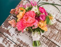 coral + orange + tropical wedding bouquet // perfect for a beach or destination wedding