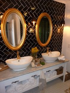 Double Sinks, Chevron Subway Tile Wall, Gold Accents, Oval Mirrors