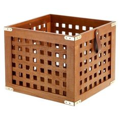 Threshold large lattice look wooden crate made from Paulownia Wood. The crate is stained a neutral brown color, features flexible handles and metal decorative accents. It is perfect for all kinds of storage and can be used in any room in the house, including the living room, family room, bedroom or home office.