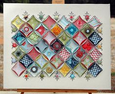Circles of scrapbook paper that resemble quilting. Very cool technique and beautiful too