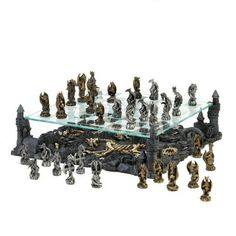 "Fire-breathing beasts battle for supremacy above the charred remains of dragon warriors that perished in this never-ending battle. Perched atop four corners of the kingdom, these winged monsters will not rest until they strategically best their opponent. A thrilling and visually stunning way to enjoy a rousing game of chess.   Tallest game piece is 2 3/4"" high;  Smallest game piece is 2 1/8"" high. For purchase click on picture or Inbox me."