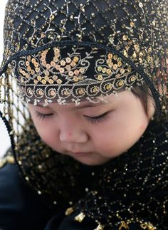 A young Chinese Muslim girl attends prayers for Eid Al-Fitr at the Niujie Mosque in Beijing, China (August 2012)