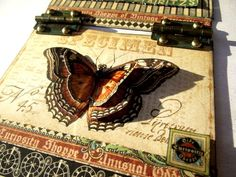 """Detail of the butterfly on Graphic 45's tag; the papers are from the new release """"Olde Curiosity Shoppe"""""""
