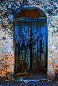 Distressed blue door in Greece