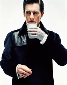Kyle MacLachlan with his coffee as Agent Dale Cooper during Twin Peaks 1990 by John Midgley.