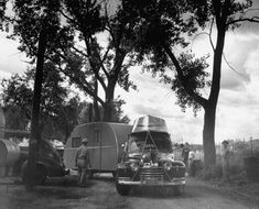 Vintage Camping. Got to have the boat!