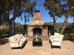 Country Club Wedding, White Tufted Lounge with Natural Accents in the Courtyard in front of the stone fireplace. Romantic, classic, timeless, elegant. From Lauren Sharon Vintage Rentals & Design | Wedding Rentals San Diego