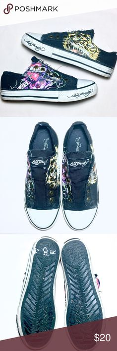 "Ed Hardy Laceless Slip-on Sneakers Gently used Ed Hardy sneakers in great condition. Laceless and slip-on, super cute with a tiger on the left side of each shoe and ""love kills slowly"" skull on the right sides. Some silver sharpie on bottom of left shoe. Canvas material. Super hot sneakers for summer. Ed Hardy Shoes Sneakers"