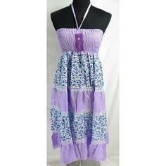 Lavender Floral Sundress light weight polyester small flower dresses. Can be used as sundresses or long skirt.   Adjustable smock front and back allowing stretch to fit in most size ranges.   One size fit most. (will only fits US Size 6, 8, 10)  Length approximately: 34 inches in length. (not include the neck tie)  Smocked top 18 inches around, can be stretched up to 34 inches around. Dresses