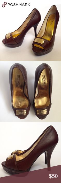 // MICHAEL KORS Brown Heels with Gold Plate // These shoes are stunning! A peep toe shows off your cute pedicure, beautiful brown leather and golden plate for added style.    • Size 6 1/2 • 1 inch platform  • 4 inch heel  • Used and in good condition, see pictures for wear. MICHAEL Michael Kors Shoes Heels