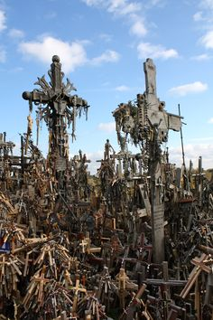 """Amid lush green hills in the Lithuanian countryside, just outside the city of Šiauliai, a strange sight greets visitors: tens of thousands of crosses, big and small, made out of metal, wood or granite are piled on top of each other.""Photograph by Kyle Taylor."