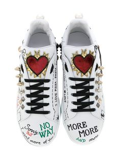 Shop Dolce & Gabbana musical patch lace-up sneakers.