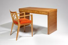 """Jean Royère (1902-1981) """"Croisillons"""" desk and its armchair, circa 1946 The rectangular oak desk opens with two drawers with a """"Croisillons"""""""