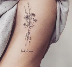 """Best Tiny Tattoo Idea - outside right wrist: """"sisters are different flowers from the same garden&qu... Check more at http://tattooviral.com/tattoo-designs/small-tattoos/tiny-tattoo-idea-outside-right-wrist-sisters-are-different-flowers-from-the-same-gardenqu/ #beautytatoos"""