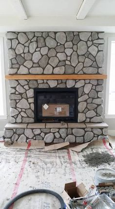 Massive rock fireplaces river stones faux river rock panels river rock fireplace using cultured stone another masonry project by lennox masonry of victoria solutioingenieria Choice Image