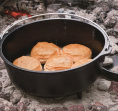 A dutch oven with a lid that you can use as a griddle.
