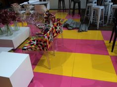 A bright yellow & pink painted & Astroturf floor for Open Design at Cape Town City Hall