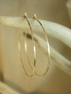 These are very dainty hammered hoops are available in 14k gold fill or fine sterling silver. Click through to shop the look now! #HandMadeJewelry #HandStampedJewelry #Style