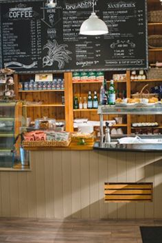 Interior design and fit out of Perry Street Cafe in Cork City. Reclaimed pine shelving for product display with contrasting panelled painted serving counters www.linehansdesign.com
