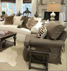 My dream living room!  Perfect example of mixing, white couches with gray, brown, black and how incorporating a gray chair will look.   Oh I can't wait to get ours soon!