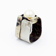 Art Jewelry: Sterling silver and Steel square band ring, set with Cultured pearl