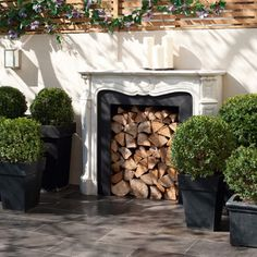 Garden wood store ~ An outdoor fireplace brings instant glamour to this garden room, while providing the perfect place for storing wood logs. Except do it with a contemporary fireplace look . Outdoor Rooms, Outdoor Gardens, Outdoor Living, Outdoor Decor, Fake Fireplace, Fireplace Design, Faux Foyer, Log Store, Classic Garden