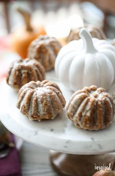 These Pumpkin Muffins with Maple Glaze make the perfect fall breakfast, brunch, or dessert treat. | Inspired by Charm