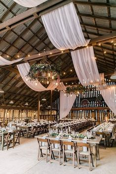 45 Romantic Barn Wedding Decorations ❤️ barn wedding decorations indoor reception idea with cloth hanging greenery and flowers on wooden tables anna delores photography #weddingforward #wedding #bride #weddingdecor #barnweddingdecorations