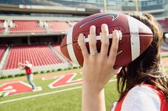 engagement pictures in a football stadium.
