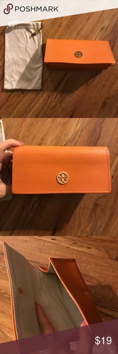 Tory burch sunglasses case and pouch Tory burch sunglasses case. Orange with gold Colored logo. Comes with adjustable pouch, also with gold logo Tory Burch Accessories