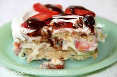 Icebox Cake - A no-bake, icebox dessert, layered with a mix of cream cheese, sweetened condensed milk and pudding, sandwiched between sheets of graham crackers scattered with a mix of fresh berries, and topped with whipped cream.