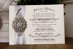 Vintage Wedding Invitation with rhinestone brooch and silver ribbon.  Printed on white gold metallic paper.  www.stephita.com