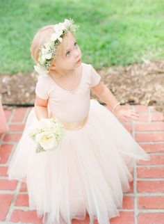 A long tutu: http://www.stylemepretty.com/2015/06/19/the-most-adorable-flower-girls-ever/