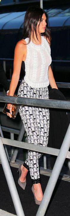 Who made Kendall Jenner's gold clutch handbag, gray sued pumps, and print pants?