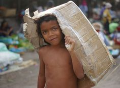 This is a candid image I snapped of a Khmer boy carrying his box just outside Psar Nath (Central Market) located in the heart of Battambang, Cambodia. Battambang Cambodia, Boy Box, Cambodia Travel, Phnom Penh, Angkor, Trip Planning, Places To Travel, Travel Photos, Travel Inspiration