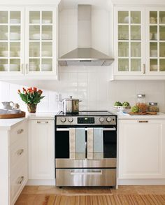 Good example of stylish stainless steel oven & range hood within a…