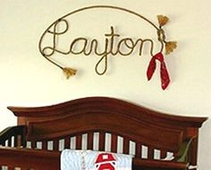 Definitely buying my little cowboy's name spelled in rope! This will go great with his wooden horse beds.