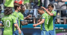 The Sounders gather around Lamar Neagle after his second goal of the game against San Jose. Photo by Dean Rutz / The Seattle Times