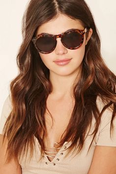 A pair of leopard print sunglasses with a round frame. #accessorize